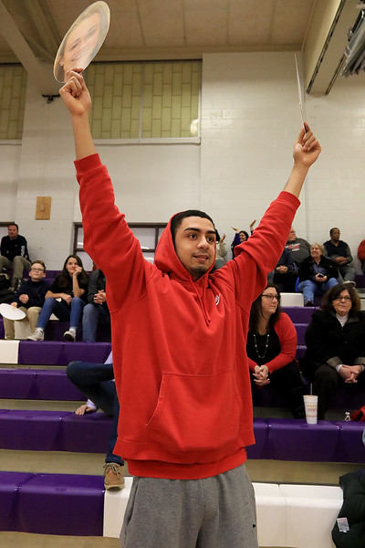 On senior night at Montachusett Regional Vocational Technical School the girls basketball team played Parker Charter School and during the game senior Monty Tech captain Erica Regan scored 20 points to put her at 1,000 points in her career at the school. Josh Gamache a friend of Regan cheers for her during the game. He was holding head shots of her. SENTINEL & ENTERPRISE/JOHN LOVE