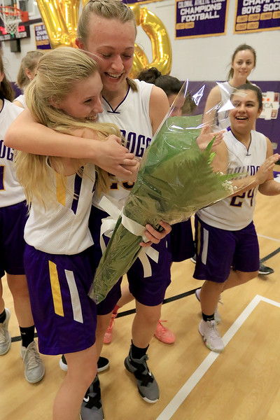 On senior night at Montachusett Regional Vocational Technical School the girls basketball team played Parker Charter School and during the game senior Monty Tech captain Erica  Regan scored 20 points to put her at 1,000 points in her career at the school. Regan gets a hug from her teammate Emily St. Thomas. SENTINEL & ENTERPRISE/JOHN LOVE