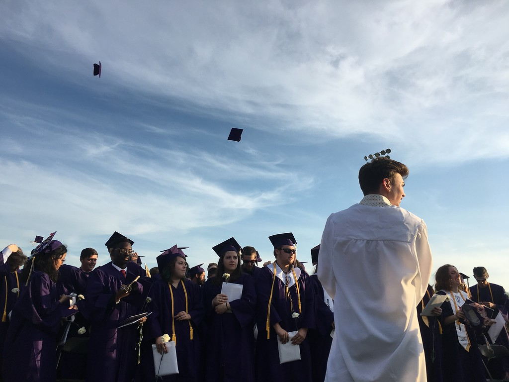 . Graduates prepare to toss their graduation caps in the air as the 2018 commencement ceremony wound down to a close. (SENTINEL & ENTERPRISE / AMANDA BURKE)