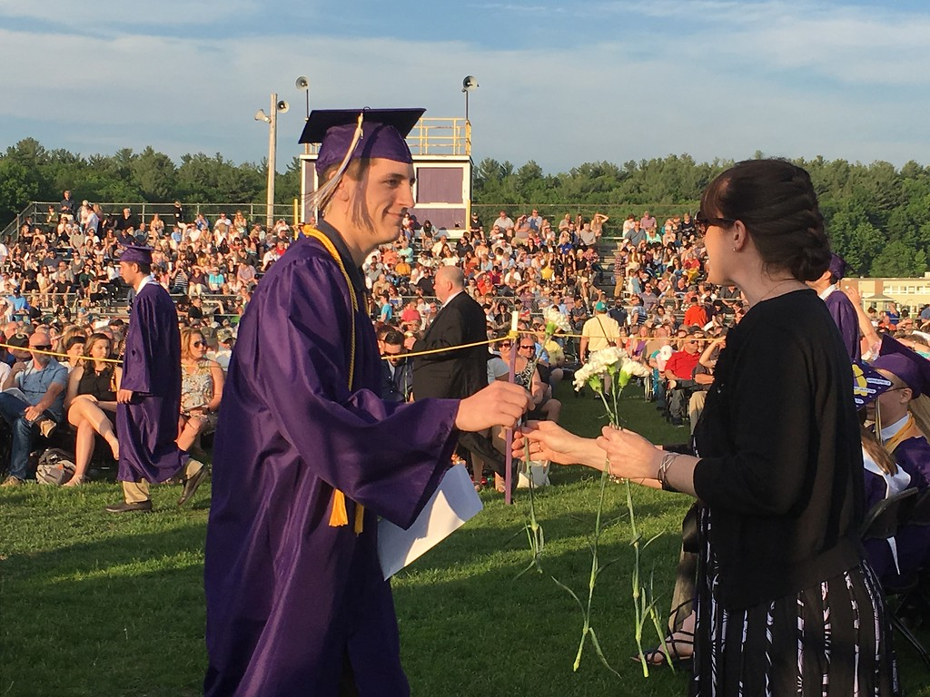 . Cole Jason Morrill, a class of 2018 graduate from Monty Tech\'s machine technology program, received a white flower from Dean of Students Katie Schmidt.  (SENTINEL & ENTERPRISE / AMANDA BURKE)