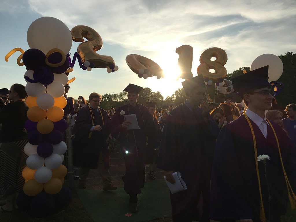 . Monty Tech class of 2018 graduates walk off of the grass field after the commencement ceremony ended Wednesday. (SENTINEL & ENTERPRISE / AMANDA BURKE)