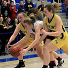 Montachusett Regional Vocational Technical School's Ashley Girouard goes after a loose ball with two Hopkins Academy players during the MIAA Basketball State Semi-Finals at Worcester State University on Wednesday night. SENTINEL & ENTERPRISE/JOHN LOVE