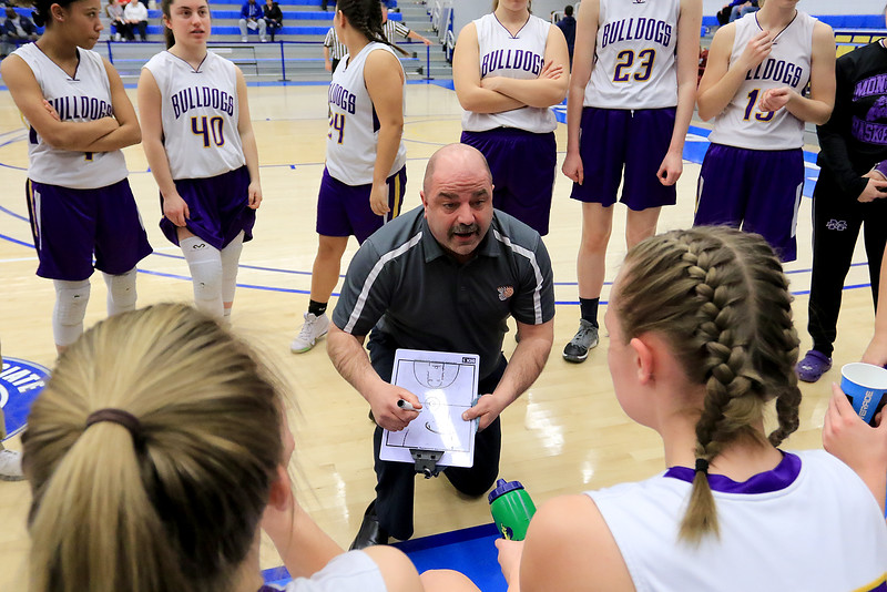 Montachusett Regional Vocational Technical School's head coach Scott Malboeuf talks to his team at a timeout during their match up with Hopkins Academy at the MIAA Basketball State Semi-Finals on Wednesdsay night at Worcester State University. SENTINEL & ENTERPRISE/JOHN LOVE