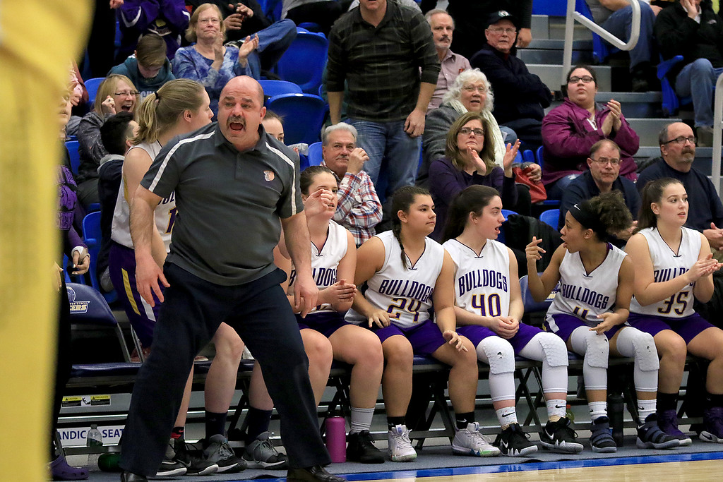 . Montachusett Regional Vocational Technical School\'s head coach Scott Malboeuf reacts to a play during their match up with Hopkins Academy at the MIAA Basketball State Semi-Finals on Wednesdsay night at Worcester State University. SENTINEL & ENTERPRISE/JOHN LOVE