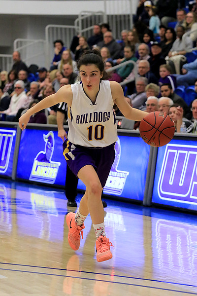 Montachusett Regional Vocational Technical School's Ashley Femino drives to the basket  during their match up with Hopkins Academy at the MIAA Basketball State Semi-Finals on Wednesday night at Worcester State University. SENTINEL & ENTERPRISE/JOHN LOVE