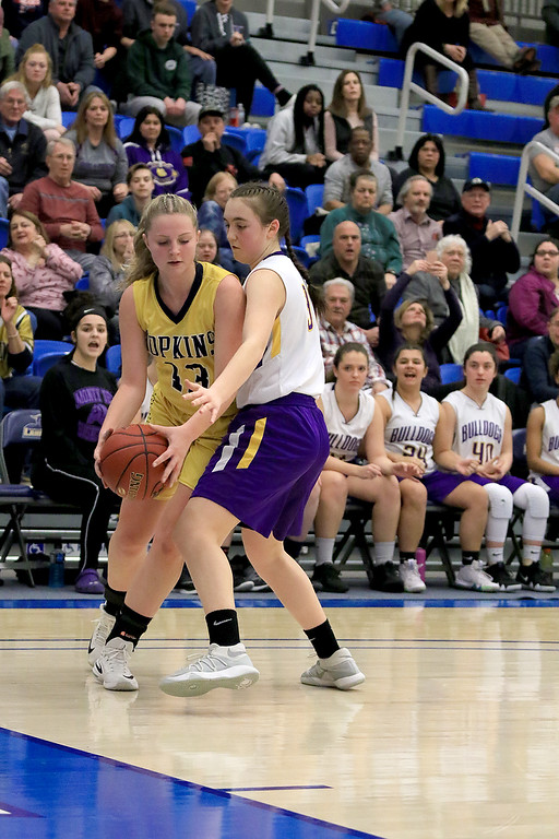 . Montachusett Regional Vocational Technical School\'s Arianna Saladini plays some full court press against Hopkins Academy\'s Sara Beauchamp at the MIAA Basketball State Semi-Finals on Wednesday night at Worcester State University. SENTINEL & ENTERPRISE/JOHN LOVE