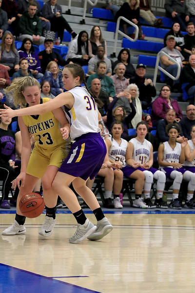 Montachusett Regional Vocational Technical School's Arianna Saladini plays some full court press against Hopkins Academy's Sara Beauchamp at the MIAA Basketball State Semi-Finals on Wednesday night at Worcester State University. SENTINEL & ENTERPRISE/JOHN LOVE
