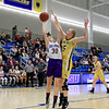 Montachusett Regional Vocational Technical School's Ashley Girouard is fouled by Hopkins Academy's Arya-Jane Mitchell during the MIAA Basketball State Semi-Finals at Worcester State University on Wednesday night. SENTINEL & ENTERPRISE/JOHN LOVE