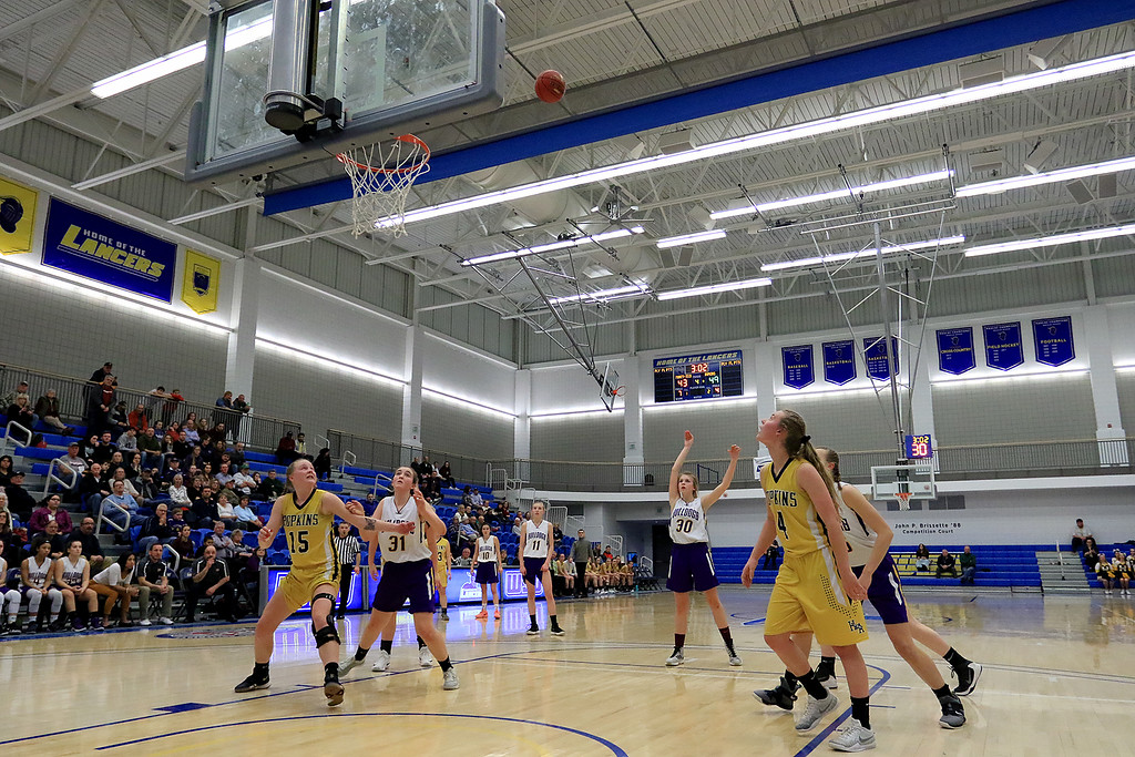 . Montachusett Regional Vocational Technical School\'s Ashley Girouard  shoots a foul shot during their match up with Hopkins Academy at the MIAA Basketball State Semi-Finals on Wednesday night at Worcester State University. SENTINEL & ENTERPRISE/JOHN LOVE