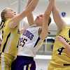 Montachusett Regional Vocational Technical School's Erica Regan goes up for a rebound with Hopkins Academy's Arya-Jane Mitchell and Thea Hanscom during the MIAA Basketball State Semi-Finals at Worcester State University on Wednesday night. Hopkins won, 55-48. SENTINEL & ENTERPRISE/JOHN LOVE