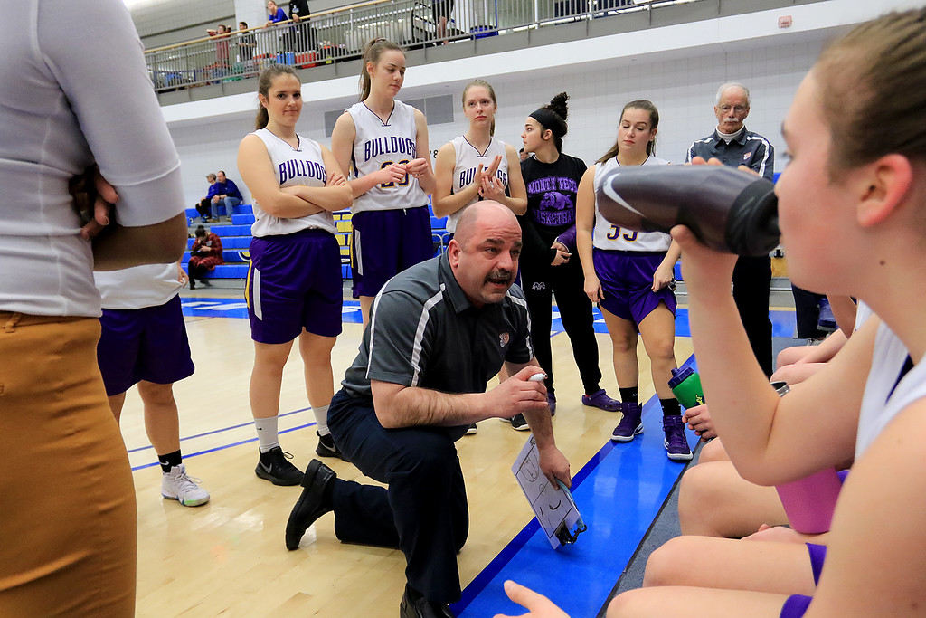 . Montachusett Regional Vocational Technical School\'s head coach Scott Malboeuf talks to his team at a timeout during their match up with Hopkins Academy at the MIAA Basketball State Semi-Finals on Wednesdsay night at Worcester State University. SENTINEL & ENTERPRISE/JOHN LOVE