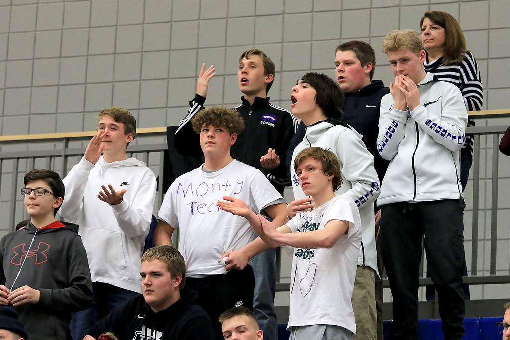 . Montachusett Regional Vocational Technical School\'s fans react to a play during their match up with Hopkins Academy at the MIAA Basketball State Semi-Finals. SENTINEL & ENTERPRISE/JOHN LOVE