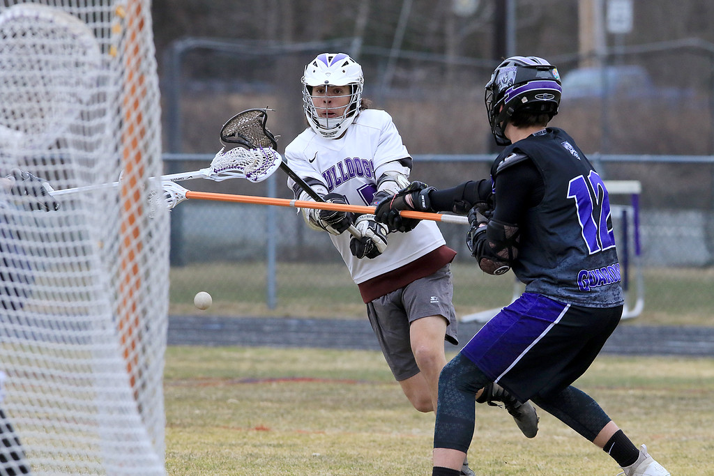 . St. Peter-Marian played Montachusett Regional Vocational Technical School on Friday, April 5, 2019. Monty Tech\'s Trent Mailman fires a shot on goal. SENTINEL & ENTERPRISE/JOHN LOVE