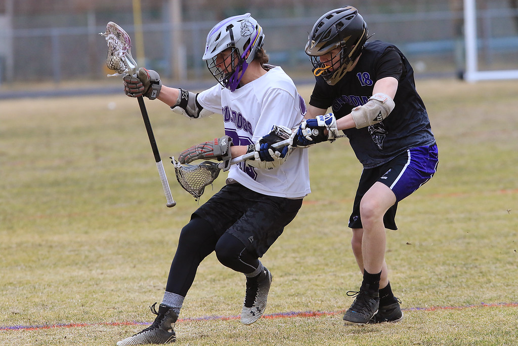 . St. Peter-Marian played Montachusett Regional Vocational Technical School on Friday, April 5, 2019. Monty Tech\'s Jake Rican tries to hold onto the ball as he is covered by St.Peter-Marian\'s Jacob Berry. SENTINEL & ENTERPRISE/JOHN LOVE