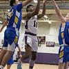 Montachusett Regional Vocational Technical School boys basketball played Assabet Valley on Thursday night, Jan. 9, 2020 in Fitchburg. AVHS's #32 Kyle Basagoard reaches to try and stop Monty Tech's #10 Cenceir Mills. SENTINEL & ENTERPRISE/JOHN LOVE
