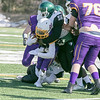 Montachusett Regional Vocational Technical School Football played Burncoat Senior High School on Saturday, March 20, 2021 at Oakmont Regional High School. Monty Tech's #5 Cenceir Mills is stopped by BSHS's #9 Jonah Familia and #56 George Paye. SENTINEL & ENTERPRISE/JOHN LOVE