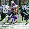 Montachusett Regional Vocational Technical School Football played Burncoat Senior High School on Saturday, March 20, 2021 at Oakmont Regional High School. Monty Tech's #6 T.J. Farr tries tries to find some running room.  SENTINEL & ENTERPRISE/JOHN LOVE