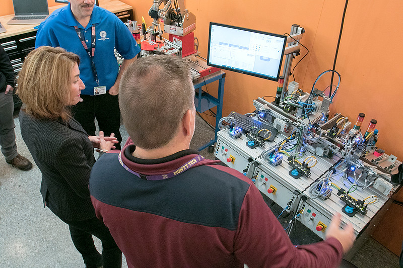 Montachusett Regional Vocational Technical High School in Fitchburg held a ribbon cutting ceremony for their new Automation, robotics, and Mechatronics Lab on Tuesday, Oct. 22, 2019. After the ribbon cutting Lt. Gov. Karyn Polito took a tour of the lab. Here she chats with Electrical Instructor Paul Cormier, in blue, and Electrical Instructor Dean Lepkokwski, back to camera, about the Lab as they stand in front of a scaled down model of a conveyor belt simulator for an automated industrial process. SENTINEL & ENTERPRISE/JOHN LOVE