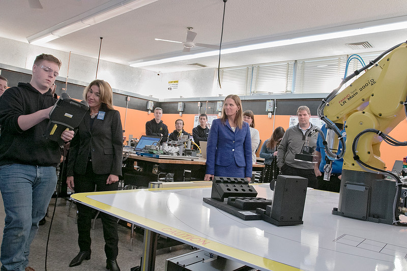 Montachusett Regional Vocational Technical High School in Fitchburg held a ribbon cutting ceremony for their new Automation, robotics, and Mechatronics Lab on Tuesday, Oct. 22, 2019. LT. Gov. Karyn Polito got a tour of the lab after the ribbon cutting. Here she watches a six axis FANUC robot as it moves objects in the lab. Showing her how it works is senior Bryan Sweeney. SENTINEL & ENTERPRISE/JOHN LOVE