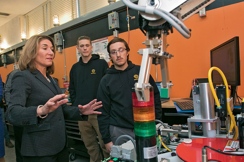 Montachusett Regional Vocational Technical High School in Fitchburg held a ribbon cutting ceremony for their new Automation, robotics, and Mechatronics Lab on Tuesday, Oct. 22, 2019. After the ribbon cutting Lt. Gov. Karyn Polito took a tour of the lab. Here she chats with senior Jarek Michalak as he explains a sorting and distributing machine that they have in the lab. SENTINEL & ENTERPRISE/JOHN LOVE