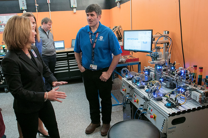 Montachusett Regional Vocational Technical High School in Fitchburg held a ribbon cutting ceremony for their new Automation, robotics, and Mechatronics Lab on Tuesday, Oct. 22, 2019. After the ribbon cutting Lt. Gov. Karyn Polito took a tour of the lab. Here she chats with Electrical Instructor Paul Cormier about the Lab as they stand in front of a scaled down model of a conveyor belt simulator for an automated industrial process. SENTINEL & ENTERPRISE/JOHN LOVE