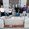 Masonry students from Monty Tech were on hand at the Fitchburg Fire Department on Wednesday, October 4, 2017 to install bricks around the base of the 9/11 monument. From left, Lt. Richard Liberatore, Isabel Bulger, Kiara Wazquez, Dante Lajara, Scott Crank, Michael Kreps, Sebastian Alonzo, Masonry Instructor Dick Demers, Phil Esposito, of Montachusett Contracting Co., and Mayor Stephen DiNatale.  SENTINEL & ENTERPRISE / Ashley Green