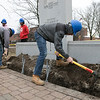 Montachusett Regional Vocational Technical School electrical students where digging a trench in front of the Fitchburg firefighters monument on the Upper Common to put in accent lighting for the monument. It should be done in time for Firefighter Sunday which is the second Sunday in June where many cities and towns in the Commonwealth honor firefighters. The little bit of rain didn't stop them as they worked hard to get it done. Senior Ryan Arakelian gets to work trying to make the trench deep enough. SENTINEL & ENTERPRISE/JOHN LOVE