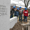 Montachusett Regional Vocational Technical School electrical students where digging a trench in front of the Fitchburg firefighters monument on the Upper Common to put in accent lighting for the monument. It should be done in time for Firefighter Sunday which is the second Sunday in June where many cities and towns in the Commonwealth honor firefighters. The little bit of rain didn't stop them as they worked hard to get it done. Students listen to instructor Paul Cormier as he tells what they will be doing next. SENTINEL & ENTERPRISE/JOHN LOVE