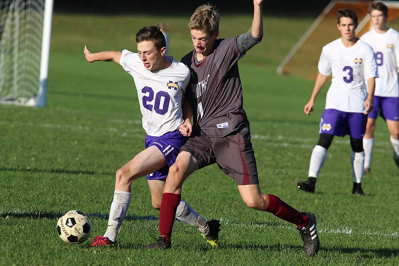 Ayer Shirley Regional High School boys soccer played Montachusett Regional Vocational Technical School on Tuesday in Fitchburg, October 31, 2017. Monty Tech's Sam Gunsalus and ASRHS's Alex Mills fight for control of the ball. SENTINEL & ENTERPRISE/JOHN LOVE