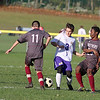Ayer Shirley Regional High School boys soccer played Montachusett Regional Vocational Technical School on Tuesday in Fitchburg, October 31, 2017. Monty Tech's Captain Andrew Colcord tries take the ball betwee ASRHS's Sebastian Costa and Fayad Bashir. SENTINEL & ENTERPRISE/JOHN LOVE
