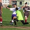 Ayer Shirley Regional High School boys soccer played Montachusett Regional Vocational Technical School on Tuesday in Fitchburg, October 31, 2017. ASRHS's goalie Nick Granger goes in to stop Monty Tech's Captain Charlie Kelley during action in the game. SENTINEL & ENTERPRISE/JOHN LOVE