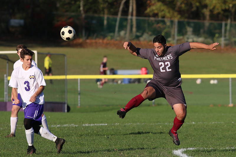 Ayer Shirley Regional High School boys soccer played Montachusett Regional Vocational Technical School on Tuesday in Fitchburg, October 31, 2017. ASRHS's Manoel de Souza gets a piece of the ball. SENTINEL & ENTERPRISE/JOHN LOVE