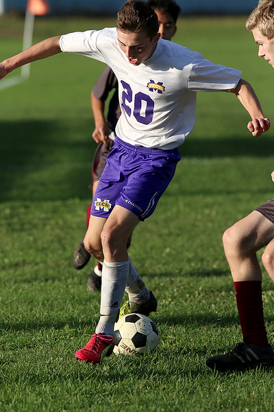 Ayer Shirley Regional High School boys soccer played Montachusett Regional Vocational Technical School on Tuesday in Fitchburg, October 31, 2017. Monty Tech's Sam Gunsalus gets control of the ball during actio0n in the game. SENTINEL & ENTERPRISE/JOHN LOVE
