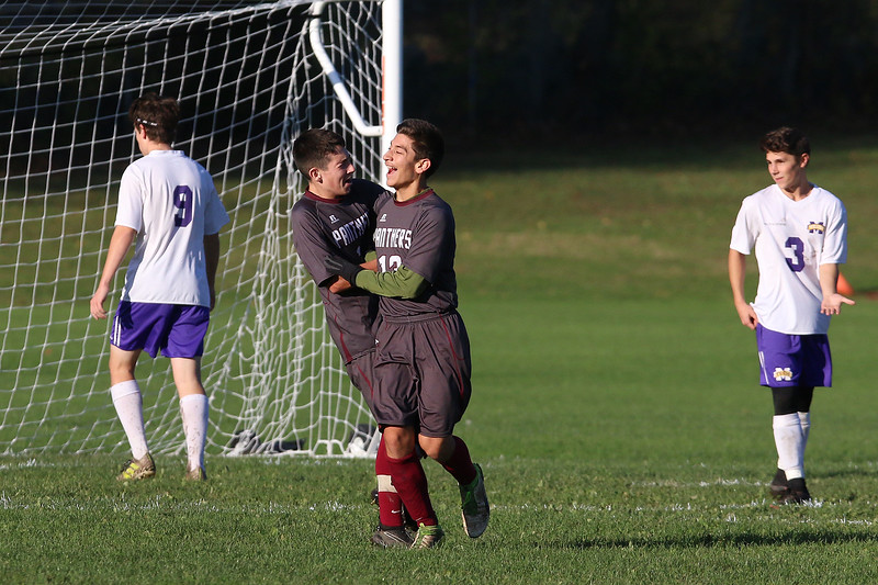 Ayer Shirley Regional High School boys soccer played Montachusett Regional Vocational Technical School on Tuesday in Fitchburg, October 31, 2017. ASRHS's Sebastian Costa, left, congratulates teammate Ariel Velasquez on his goal. SENTINEL & ENTERPRISE/JOHN LOVE