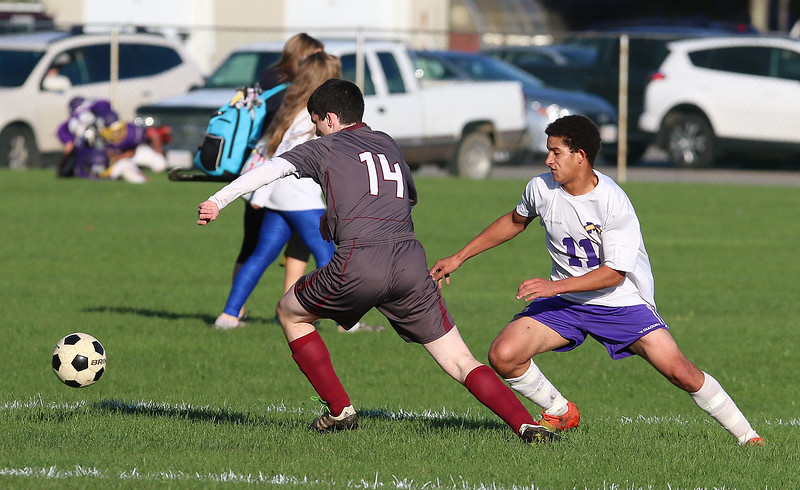 Ayer Shirley Regional High School boys soccer played Montachusett Regional Vocational Technical School on Tuesday in Fitchburg, October 31, 2017. ASRHS's Ryan Kilcommins goes after the ball with Monty Tech's Captain Charlie Kelley just behind him. SENTINEL & ENTERPRISE/JOHN LOVE