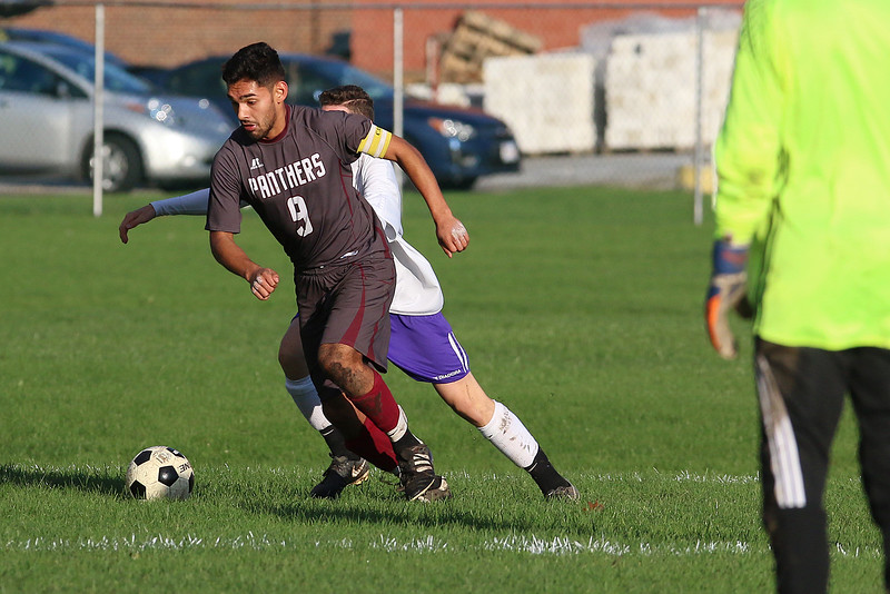 Ayer Shirley Regional High School boys soccer played Montachusett Regional Vocational Technical School on Tuesday in Fitchburg, October 31, 2017. ASRHS's Leonardo Rosales takes control of the ball from Monty Tech's Jayce Lajoy, just behind him, during action in the game. SENTINEL & ENTERPRISE/JOHN LOVE
