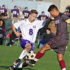 Ayer Shirley Regional High School boys soccer played Montachusett Regional Vocational Technical School on Tuesday in Fitchburg, October 31, 2017. Monty Tech's Cody Bridge and ASRHS's Leonardo Rosales fight for control of the ball.  SENTINEL & ENTERPRISE/JOHN LOVE