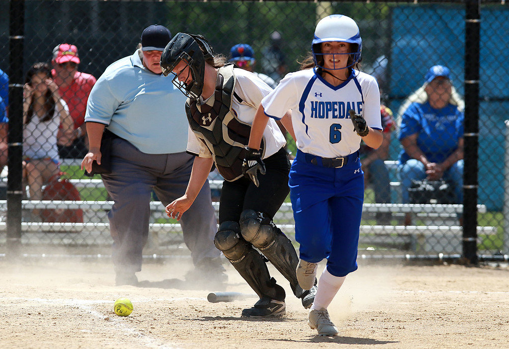 . Montachusett Regional Vocational Technical School Softball played Hopedale High School on Saturday afternoon at at Worcester State University for the Central Mass. Division 3 championship. Hopedale player Lucia Rolo runds down the first baseline as Monty tech\'s catcher Kiera McNamara goes after the ball. SENTINEL & ENTERPRISE/JOHN LOVE
