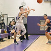 Montachusett Regional Vocational Technical School player Kyle Kane inbounds the ball as Joseph P. Keefe Technical Vocational School player Jeynardo Gomez covers him during their match up on Thursday night. SENTINEL & ENTERPRISE/JOHN LOVE