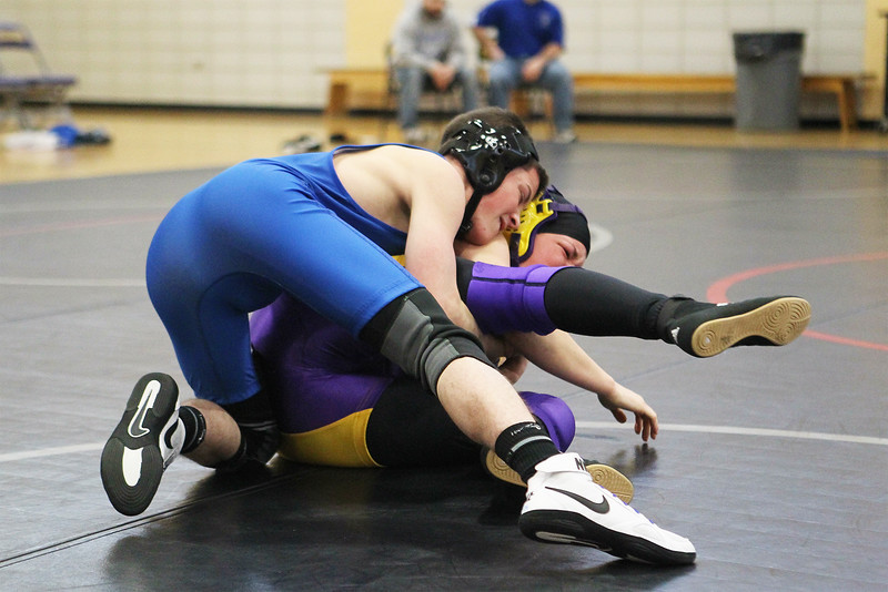 Leominster's Dmitri Gagnon, top, grapples with Monty Tech's Chelsey Wasiatka during a match at Monty Tech on Saturday, Dec. 31, 2016. Monty Tech won the match, 48-24. SENTINEL & ENTERPRISE / SCOTT LAPRADE