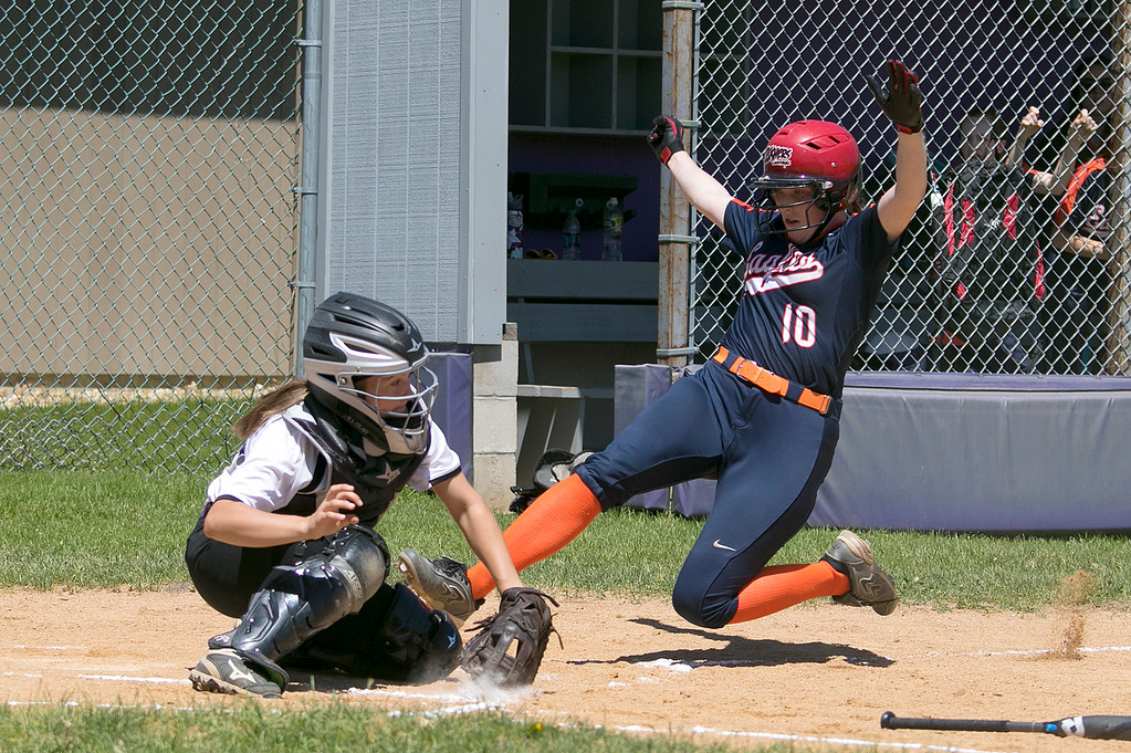 . Montachusett Regional Vocational Technical School softball played Advanced Math and Science Academy Charter School on Saturday morning, June 8, 2019 during the Central Mass. Division 3 first round Playoff game. AMSACS player Ella Kinney slides safe into home as Monty Tech catcher Hannah Seymour reaches for the throw. SENTINEL & ENTERPRISE/JOHN LOVE