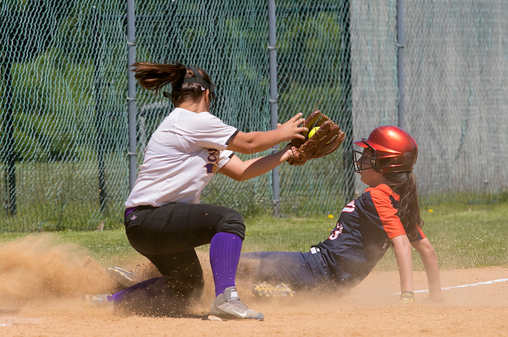 . Montachusett Regional Vocational Technical School softball played Advanced Math and Science Academy Charter School on Saturday morning, June 8, 2019 during the Central Mass. Division 3 first round Playoff game. The throw to Monty Tech\'s Amber Colcord was just a few seconds late and AMSACS\'s Isabella Rand slides into to third safe. SENTINEL & ENTERPRISE/JOHN LOVE