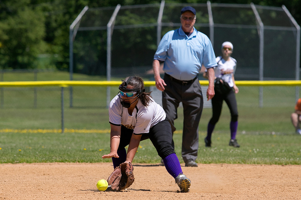 . Montachusett Regional Vocational Technical School softball played Advanced Math and Science Academy Charter School on Saturday morning, June 8, 2019 during the Central Mass. Division 3 first round Playoff game. Monty Tech\'s Amber Colcord picks up a ground ball. SENTINEL & ENTERPRISE/JOHN LOVE