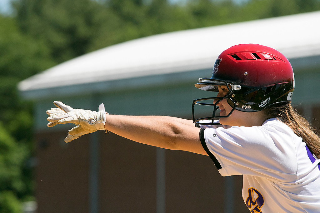. Montachusett Regional Vocational Technical School softball played Advanced Math and Science Academy Charter School on Saturday morning, June 8, 2019 during the Central Mass. Division 3 first round Playoff game. Monty Tech\'s Hannah Seymour makes a gesture to her teammates after making her way to first during action in the game. SENTINEL & ENTERPRISE/JOHN LOVE