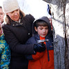 HOLLY PELCZYNSKI - BENNINGTON BANNER  4th grader Kyler Aiken gets some help tapping a sugar maple from Monument Elemntary school principle Donna Cauley  on Friday morning in Bennington.