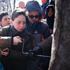 HOLLY PELCZYNSKI - BENNINGTON BANNER  Fifth graders Charlie Thompson and Jason Vickers tap a sugar maple tree with their classmates at Monument Elementary school in Bennington on Friday morning.