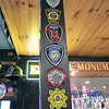 Owner of The Monument Tap in Leominster Mike Cooley talks about putting his place up for sale Tuesday morning, Jan. 14, 2020. His bar area is covered in badges he has collected from customers. SENTINEL & ENTERPRISE/JOHN LOVE