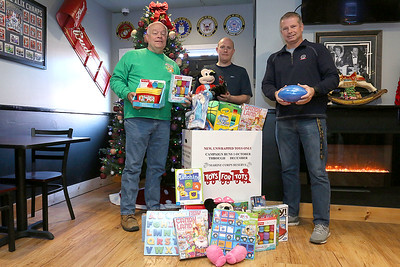 Monument Tap gives Toys to Fire Department, Dec. 4, 2017