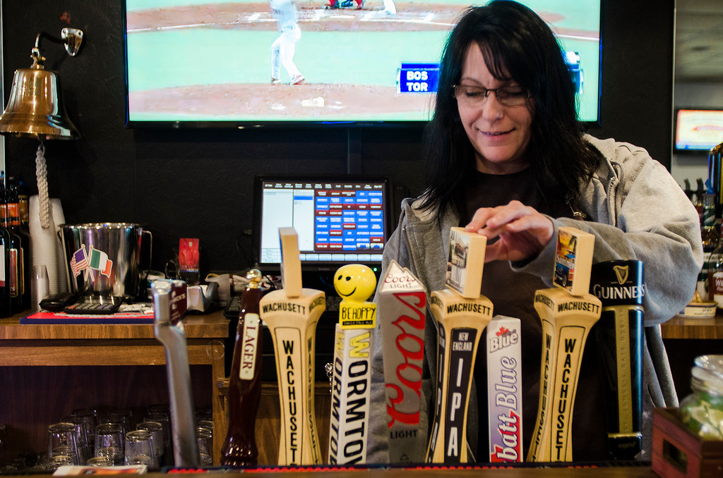 . The Monument Tap, formerly The Tankard,  has been purchased and rennovated by Leominster\'s Mike Cooley. Bartender Melissa Mazzaferro tends to customers on Thursday, April 20, 2017. SENTINEL & ENTERPRISE / Ashley Green