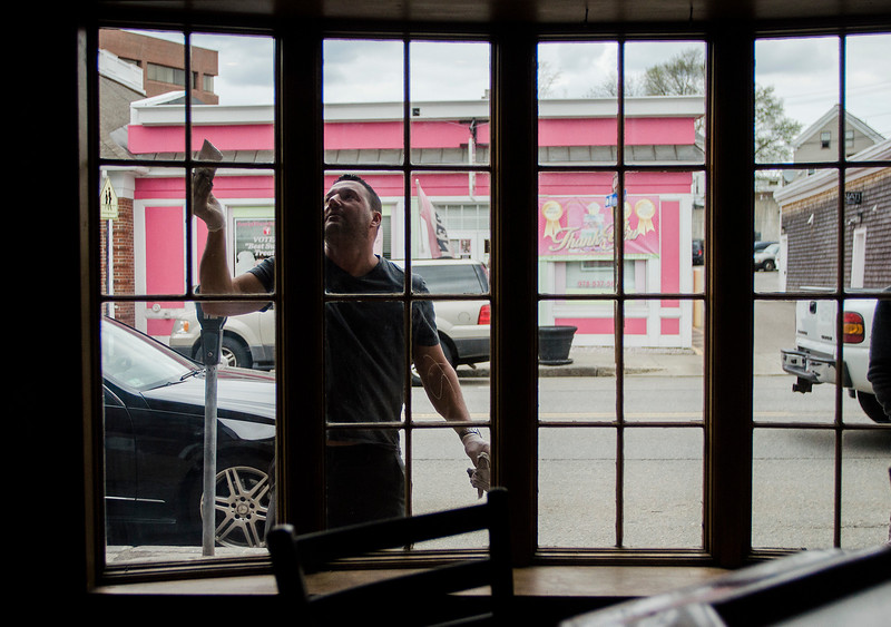 The Monument Tap, formerly The Tankard,  has been purchased and rennovated by Leominster's Mike Cooley. Ken Ricker paints the enterior of the windows on Thursday, April 20, 2017. SENTINEL & ENTERPRISE / Ashley Green